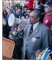 Senator Gomes at workers rally.