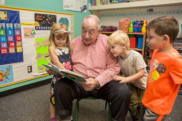 Senator Leone with local children