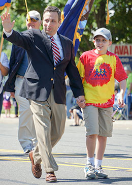 Senator Duff and his son in the Memorial Day Parade.