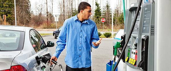 customer at gas pump.