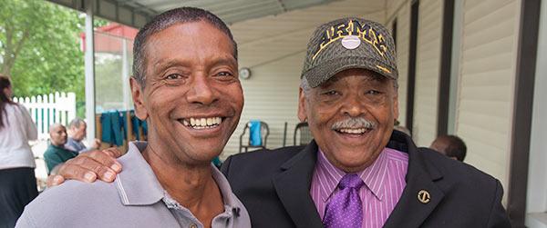 Senator Gomes with veteran.