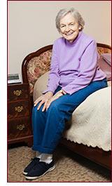 senior woman on bed