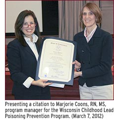 Presenting a citation to Marjorie Coons, RN, MS, program manager for the Wisconsin Childhood Lead Poisoning Prevention Program. (March 7, 2012)