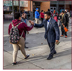 greeting students