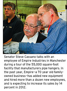 Senator Steve Cassano talks with an employee of Empire Industries in Manchesterduring a tour of the 55,000 square-foot facility that manufacturers pipe hangers. In the past year, Empire has added new equipment and hired more than a dozen new employees.