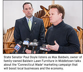State Senator Paul Doyle listens as Max Baldwin, owner of family-owned Baldwin Lawn Furniture in Middletown talks about the 'Connecticut Made' marketing campaign that will boost local businesses and the economy.