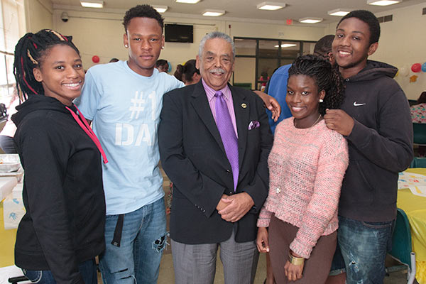 Senator Gomes with young people.