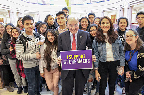 photo of Senator Looney with Dreamers.